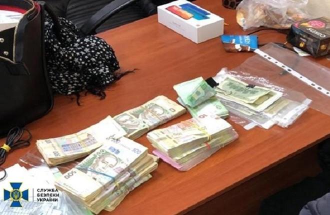 Оборот мільйонний. У Києві накрили підпільний обмінник криптовалюти